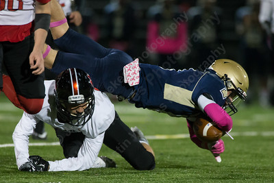 Platt's Jake Baker dives for extra yards after a reception Friday at Falcon Field in Meriden October 27, 2017 | Justin Weekes / For the Record-Journal