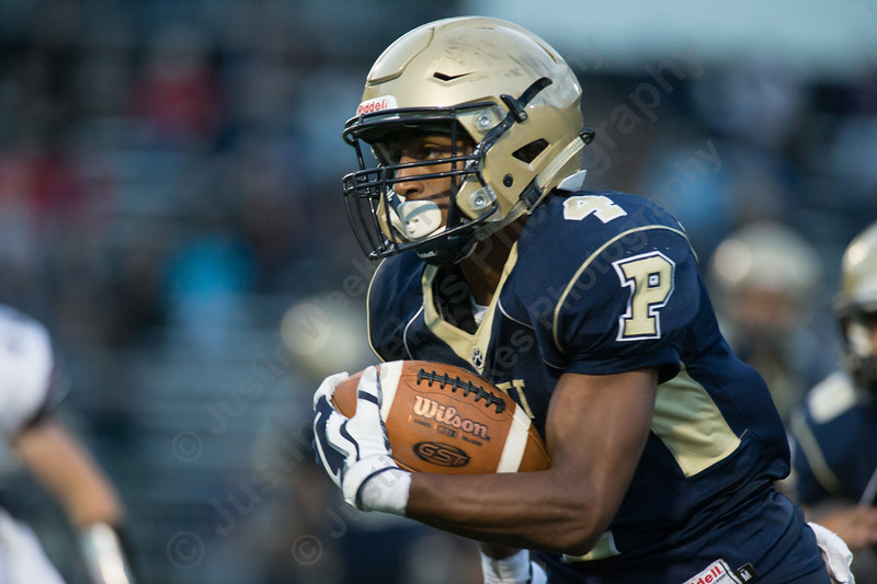 Platt's EJ Dudley carries the ball in the second quarter Friday during the season opener at Falcon Field in Meriden Sep. 8, 2017 | Justin Weekes / For the Record-Journal