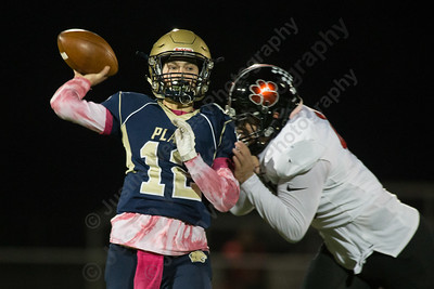 Platt's AJ Marinelli gets hit by E O Smith's Rondell Bothroyd resulting in an interception Friday at Falcon Field in Meriden October 27, 2017 | Justin Weekes / For the Record-Journal
