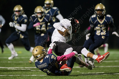 Platt's Lorenzo Sanson brings down E O Smith's Kobe Stigler for a loss Friday at Falcon Field in Meriden October 27, 2017 | Justin Weekes / For the Record-Journal