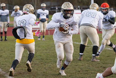 Platt's EJ Dudley takes the hand off Wednesday as the Panthers prepare for the Stoddard Bowl at Platt High School in Meriden November 15, 2017 | Justin Weekes / For the Record-Journal
