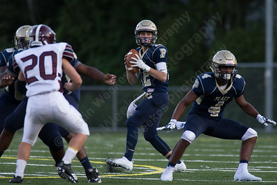 Platt's quarterback AJ Marinelli looks for a receiver down field on their opening drive Friday during the season opener at Falcon Field in Meriden Sep. 8, 2017 Platt defeated Farmington 42 to 7.    Justin Weekes / For the Record-Journal