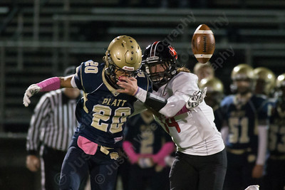 E O Smith's Thomas Pavliscsak breaks up a pass to Platt's Elijah Felton Friday at Falcon Field in Meriden October 27, 2017 | Justin Weekes / For the Record-Journal