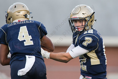Platt's quarterback AJ Marinelli  hands off to EJ Dudley Friday during the season opener at Falcon Field in Meriden Sep. 8, 2017 Platt defeated Farmington 42 to 7.   Justin Weekes / For the Record-Journal