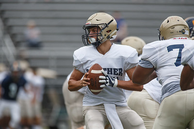 Platt's Lorenzo Sanson drops back Friday during a pre-season scrimmage with Simsbury at Falcon Field in Meriden August 31, 2018 | Justin Weekes / Special to the Record-Journal