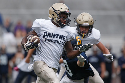 Platt's  Tremayne Carter return a punt for a touchdown Friday during a pre-season scrimmage with Simsbury at Falcon Field in Meriden August 31, 2018 | Justin Weekes / Special to the Record-Journal