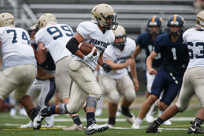 Platt's Roberto Salas looks for a hole Friday during a pre-season scrimmage with Simsbury at Falcon Field in Meriden August 31, 2018 | Justin Weekes / Special to the Record-Journal