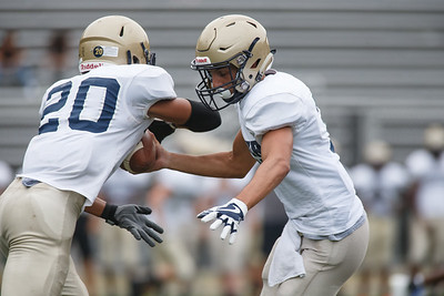 Platt's Lorenzo Sanson hands off to Roberto Salas Friday during a pre-season scrimmage with Simsbury at Falcon Field in Meriden August 31, 2018 | Justin Weekes / Special to the Record-Journal