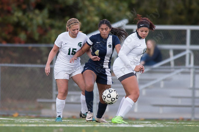 Platt's Emily Nava splits Maloney defenders Monday at Falcon Field in Meriden October 30, 2017 | Justin Weekes / For the Record-Journal