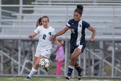 Platt's Madison Chatman and Platt's Olivia Aitken battle for control Monday at Falcon Field in Meriden October 30, 2017 | Justin Weekes / For the Record-Journal