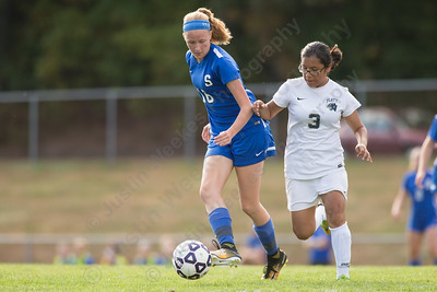 Southington's Abigail Sowa works past Platt's Nayely Salazar Friday at Platt High School in Meriden October 6, 2017 | Justin Weekes / For the Record-Journal