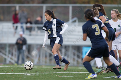 Platt's Iyairing Perea pushes up field Monday at Falcon Field in Meriden October 30, 2017 | Justin Weekes / For the Record-Journal