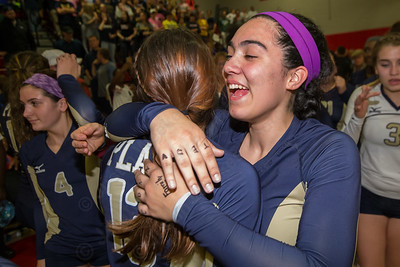 Platt's Maria Duffy and Jenixza Febles hug after beating RHAM Saturday during the class L state final at Berlin High School in Berlin Nov. 21, 2015 | Justin Weekes / For the Record-Journal