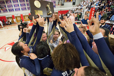 Platt Gabriela Vazquez and her team mates  hoists the class L volley ball plaque Saturday after beating RHAM 3-1 at Berlin High School in Berlin Nov. 21, 2015 | Justin Weekes / For the Record-Journal