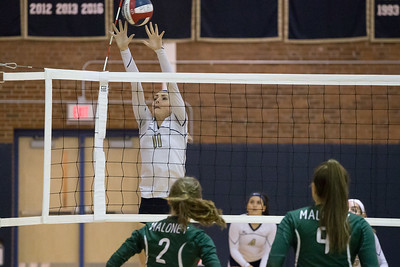 Platt's Jennifer Rita gets a piece of a Maloney spike Thursday at Platt High School in Meriden October 26, 2017 | Justin Weekes / For the Record-Journal