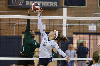 Platt's Caitlyn Hart and Maloney's Shanice Smith battle at the net Thursday at Platt High School in Meriden October 26, 2017 | Justin Weekes / For the Record-Journal