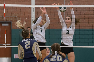 Maloney's Grace Anetrella (3) and Laila Martinez jump to block Platt's Vanessa Isyk Monday at Maloney High School in Meriden October 2, 2017 | Justin Weekes / For the Record-Journal