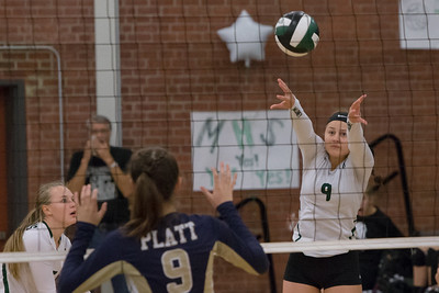 Maloney's Melanie Polanco plays a touch over the net Monday at Maloney High School in Meriden October 2, 2017 | Justin Weekes / For the Record-Journal