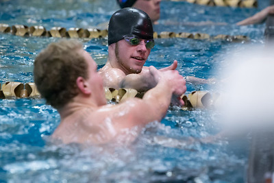 Meriden Co op's Preston Lewis and Berlin's Adrian Wojtun shake hands after the 50 freestyle Friday at Platt High School in Meriden Feb. 19, 2016 | Justin Weekes / For the Record-Journal