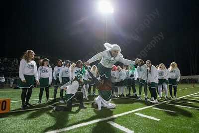 Maloney's Bryan Sayuay jumps through Damian Pantula's legs to get the Spartan cheerleaders fired up Monday during the Meriden Powder Puff game at Falcon Field in Meriden. Platt defeated Maloney 35 to 31. November 20, 2017 | Justin Weekes / For the Record-Journal