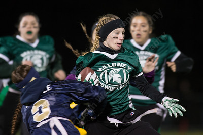 Maloney's Charlotte  Lavin runs for a first down Monday during the Meriden Powder Puff game at Falcon Field in Meriden. Platt defeated Maloney 35 to 31. November 20, 2017 | Justin Weekes / For the Record-Journal