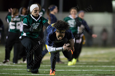 Platt's Kiara Lopez catches a pass from Vanessa Isyk Monday during the Meriden Powder Puff game at Falcon Field in Meriden. Platt defeated Maloney 35 to 31. November 20, 2017 | Justin Weekes / For the Record-Journal