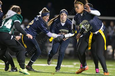 Platt's Vanessa Isyk hands off to Nancy Garcia Monday during the Meriden Powder Puff game at Falcon Field in Meriden. Platt defeated Maloney 35 to 31. November 20, 2017 | Justin Weekes / For the Record-Journal