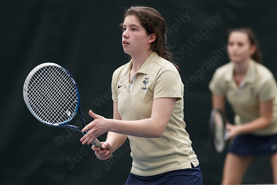 Platt's Ava Musner left and Rachel Greenburg in a doubles match with Maloney Thursday at The Tennis Center in Newington Apr. 16, 2015 | Justin Weekes / For the Record-Journal