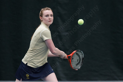 Platt's Shannon McEnerney lines up a back hand volley Thursday at The Tennis Center in Newington Apr. 16, 2015 | Justin Weekes / For the Record-Journal