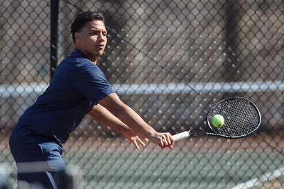 Platt's Edy Gomez reaches for a back hand serve return of Wilcox Tech's Alan Chen Monday at Wilcox Tech High School in Meriden  Apr. 13, 2015 | Justin Weekes / For the Record-Journal