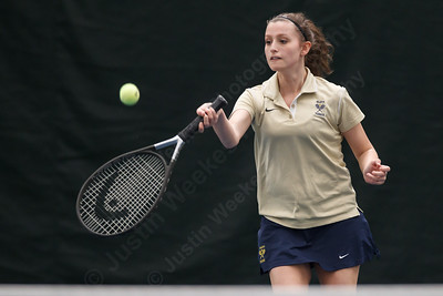 Platt's Rachel Greenburg goes for a drop shot in a doubles match Thursday at The Tennis Center in Newington Apr. 16, 2015 | Justin Weekes / For the Record-Journal