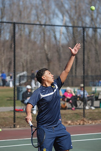 Platt's Edy Gomez serves to Wilcox Tech's Alan Chen Monday at Wilcox Tech High School in Meriden  Apr. 13, 2015 | Justin Weekes / For the Record-Journal