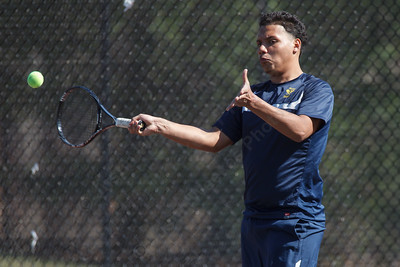 Platt's Edy Gomez hit s forehand shot during a volley with Wilcox Tech's Alan Chen Monday at Wilcox Tech High School in Meriden  Apr. 13, 2015 | Justin Weekes / For the Record-Journal