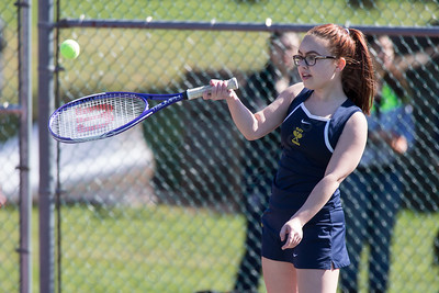 Platt's Emily Wozniak plays a lob Thursday at Washington Park in Meriden  Apr. 14, 2016 | Justin Weekes / For the Record-Journal