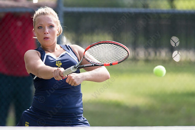 Platt's Alicja Kurzatkowski plays a volley at the net in her match with Maloney's Katherine Longworth Friday at Columbus Park in Meriden July,26 2014 | Justin Weekes For the Record-Journal