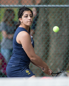 Platt's Haneen Hamdan plays a backhand volley in her match with Maloney's Domonique Carnot  Friday at Columbus Park in Meriden July,26 2014 | Justin Weekes For the Record-Journal