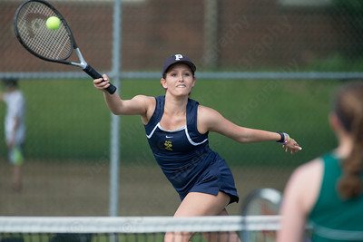 Platt's Rachel Greenburg reaches to play a forehand volley at the net Friday at Columbus Park in Meriden July,26 2014 | Justin Weekes For the Record-Journal