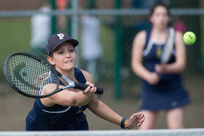 Platt's Rachel Greenburg plays a touch shot at the net in her doubles match with Ava Misner Friday at Columbus Park in Meriden July,26 2014 | Justin Weekes For the Record-Journal