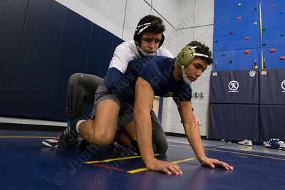 Platt's Zavian Arroyo works with Mahmoud Hassan Tuesday during practice at Platt High School in Meriden December 12, 2017 | Justin Weekes / For the Record-Journal