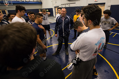 Platt's head coach Bryan McCarty talks with wrestlers Tuesday during practice at Platt High School in Meriden December 12, 2017 | Justin Weekes / For the Record-Journal