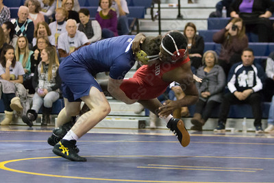 Platt's Ben Stratton takes down Conard's Tai Craig Jr Wednesday during the season opener at Platt High School in Meriden December 13, 2017 | Justin Weekes / For the Record-Journal
