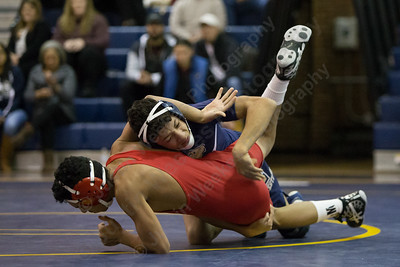 Platt's James Rondini takes down Conard's Joshua Ardon Wednesday during the season opener at Platt High School in Meriden December 13, 2017 | Justin Weekes / For the Record-Journal