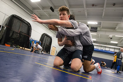 Platt's Ben Stratton works with Mannash Carlson Tuesday during practice at Platt High School in Meriden December 12, 2017 | Justin Weekes / For the Record-Journal