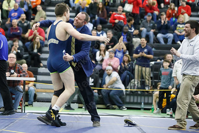 Platt's Ben Stratton celebrates with head coach Brian McCarty after pinning Killingly's Zach Caffrey Saturday at the CIAC State Wrestling Open at Flyod Little Athletic Center in New Haven February 24, 2018 | Justin Weekes / Special to the Record-Journal