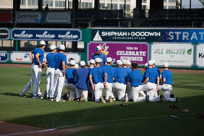Southington's head coach Charles Lembo talks with players Thursday at Dunkin' Donuts Park in Hartford May 10, 2018 | Justin Weekes / Special to the Record-Journal