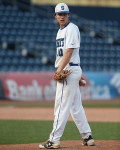 Southington's Jeremy Mercier checks the runner at first Thursday at Dunkin' Donuts Park in Hartford May 10, 2018 | Justin Weekes / Special to the Record-Journal