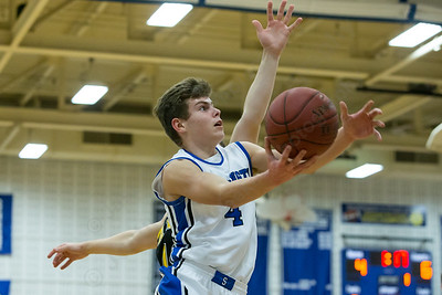 Southington's Brendan Taylor (4) gets past Amity's Michael Stewart (10) for a layup Tuesday at Southington High School in Southington Dec. 29, 2015 | Justin Weekes / For the Record-Journal