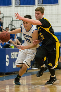 Southington's Jeremy Mercier (33) gets fouled by Amity's John Nolan (15)  Tuesday at Southington High School in Southington Dec. 29, 2015 | Justin Weekes / For the Record-Journal
