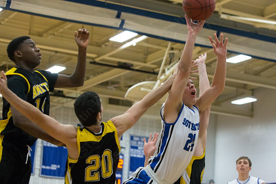 Southington's Mark Lindberg (24) gets fouled by Amity's Elias Oliphant (20) Tuesday at Southington High School in Southington Dec. 29, 2015 | Justin Weekes / For the Record-Journal