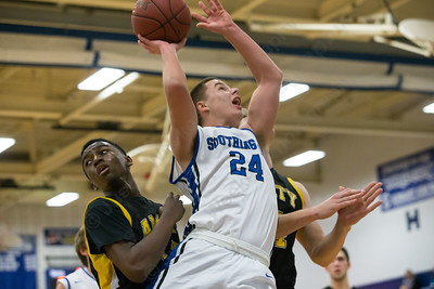 Southington's Mark Lindberg (24) puts in a layup Tuesday at Southington High School in Southington Dec. 29, 2015 | Justin Weekes / For the Record-Journal